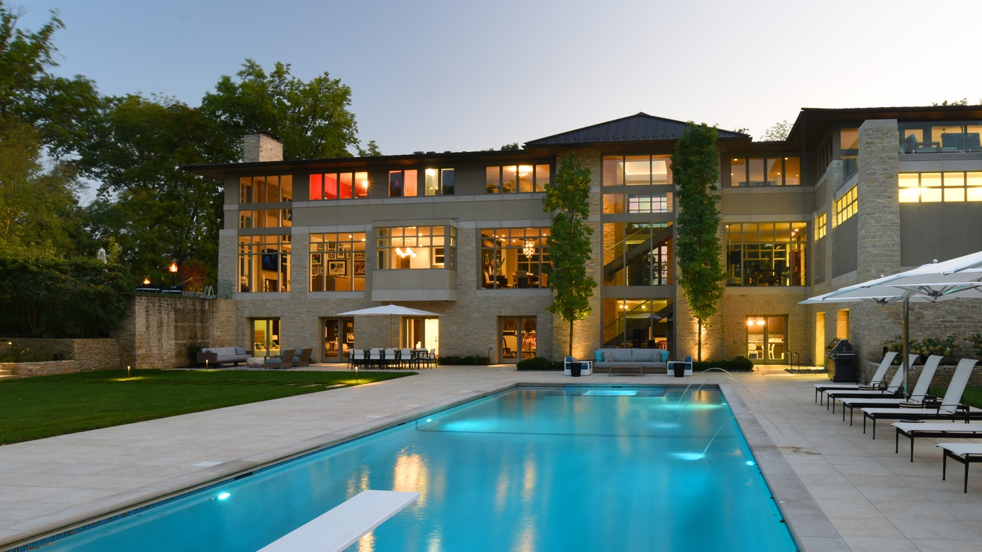 custom home with in-ground pool