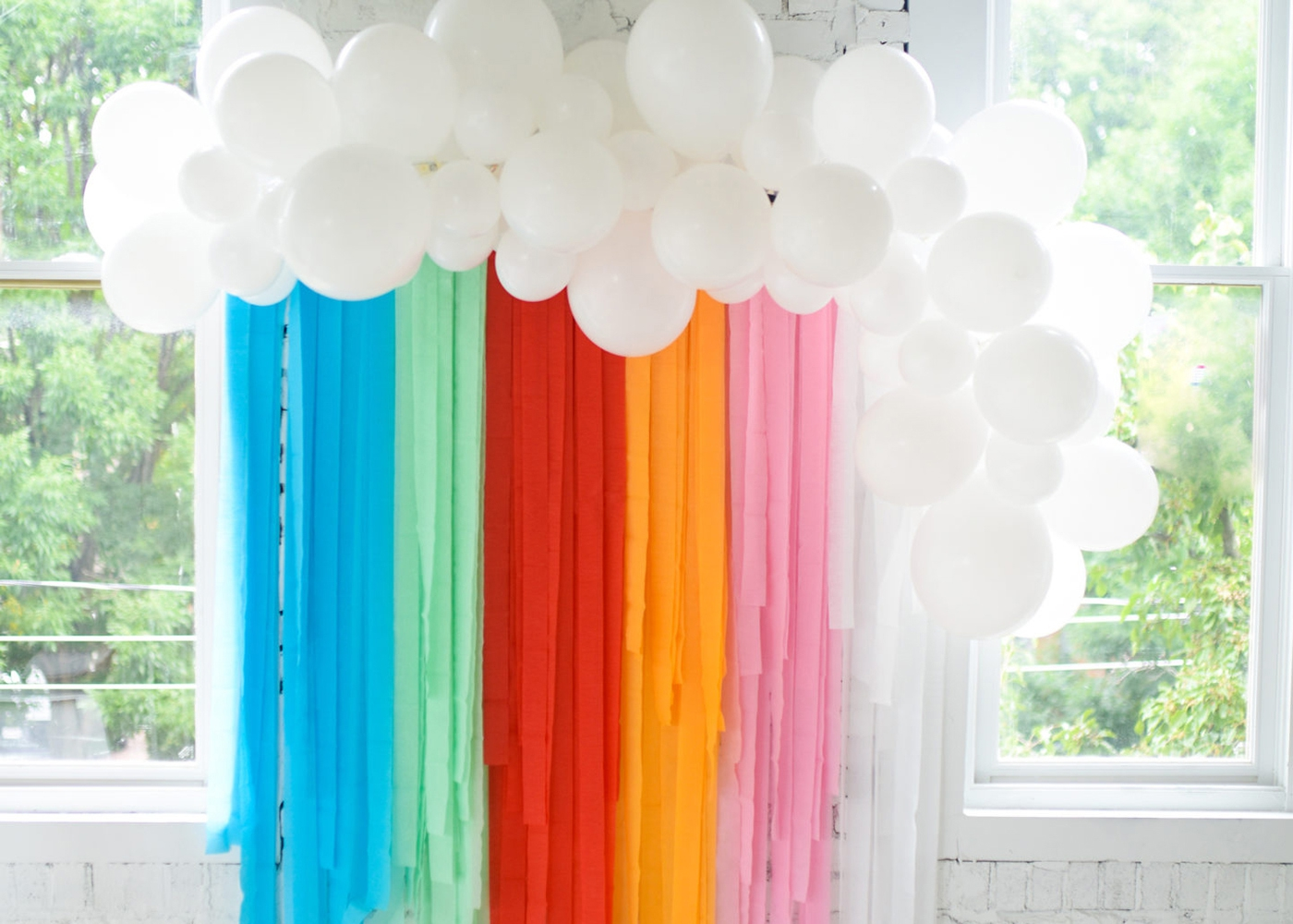 rainbow party streamers with white balloons