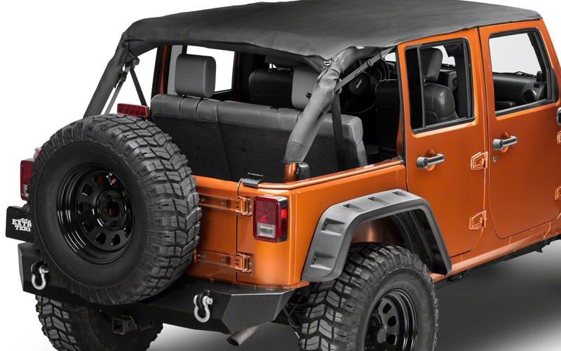 orange jeep with soft top