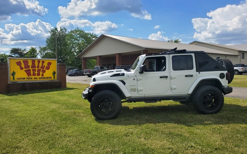 white jeep out front of Trails West